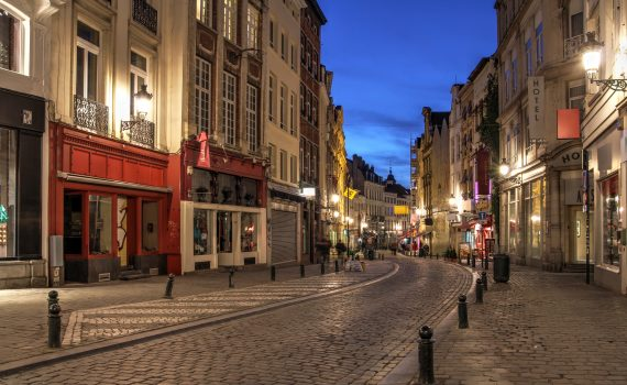A winding street in downtown Brussels, Belgium at night.
